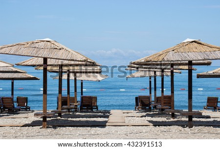 Sun umbrella with chairs on beach