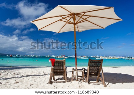 Sun umbrella with Santa Hat on chair longue