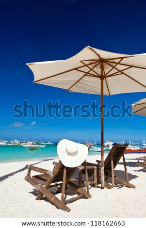 Sun umbrella with Sun Hat on chair longue