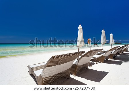 Sun umbrellas and beach chairs on a beautiful island, Philippines, Boracay