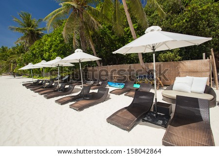 Sun umbrellas and beach chairs on coastline, Philippines, Boracay  - stock photo
