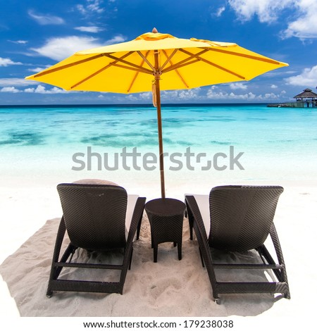 Sun umbrellas and chairs on caribbean beach