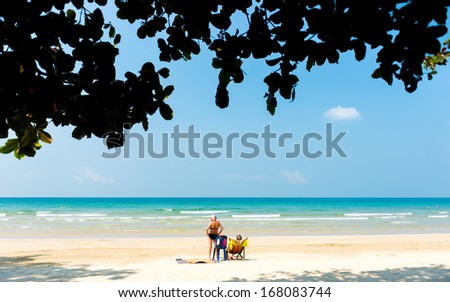 Sunbath in Koh Chang in Thailand among beautiful beach and wrom weather - stock photo