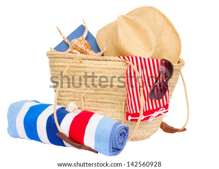 sunbathing accessories in bag and towel isolated on white background - stock photo