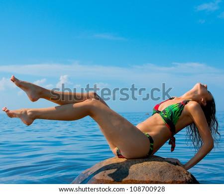 Sunbathing Beach Recreation - stock photo