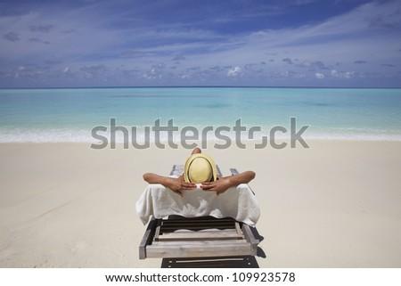 Sunbathing on Maldives Beach - stock photo