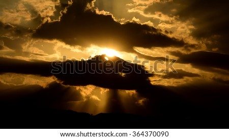 sunbeam light of heaven from the dark sky - stock photo