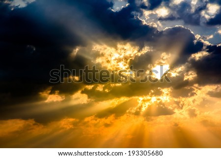 Sunbeam ray light through cloud sky twilight color blue and orange Dramatic background