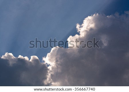 Sunbeam through cloud in the sky. - stock photo