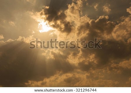 sunbeam through the clouds of sunlight in gold sky background - stock photo