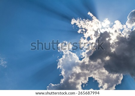 Sunbeam through the haze on blue sky: can be used as background and dramatic look - stock photo