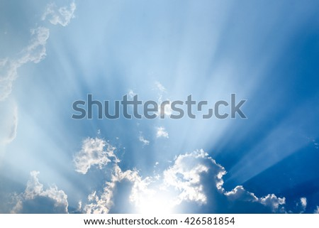 Sunbeam through the haze on blue sky , clouds with sun rays - stock photo