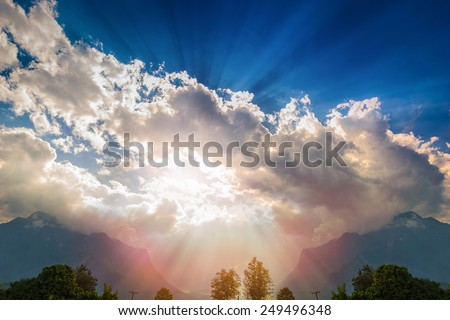 Sunbeam through the haze on blue sky  super light from God to many layer  fill with terror  formidable - stock photo