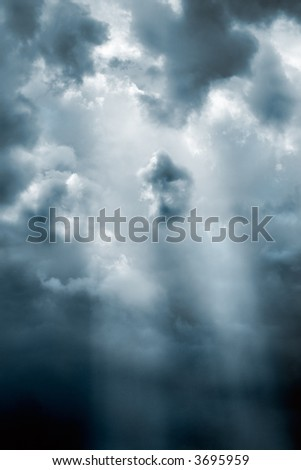 Sunbeam through the storm clouds(slightly cyan toned) - stock photo