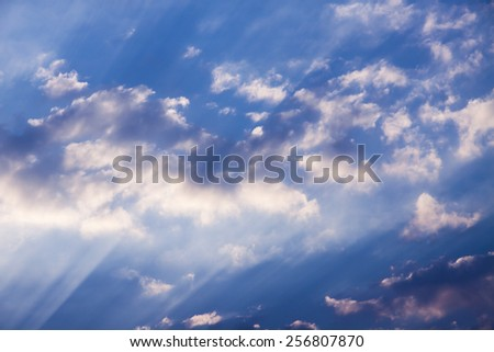 sunbeams and clouds , Beautiful blue sky with sunbeams and clouds. Sun rays. - stock photo