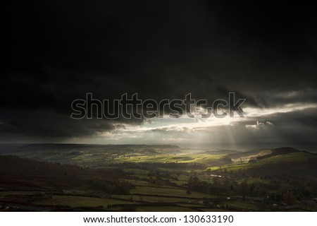 Sunbeams over Big Moor in Peak District National Park in Autumn - stock photo