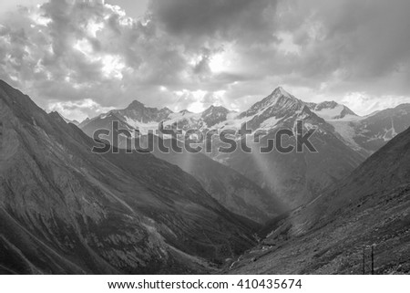 Sunbeams resting on the valley floor with the Weisshorn as a backdrop in Wallis, Switzerland - stock photo