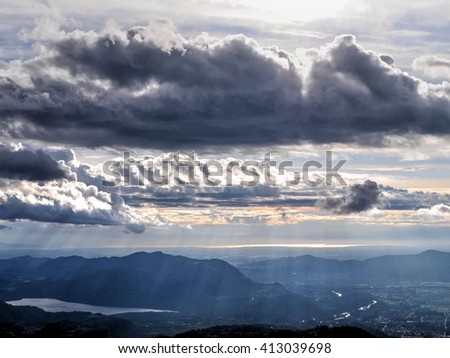 Sunbeams Though Clouds.  Gorgeous sun rays from Elk Mountain, Chilliwack, British Columbia, Canada.  - stock photo