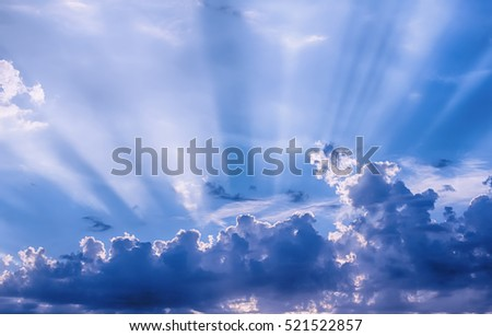 Sunbeams through the clouds, dramatic summer sky.
