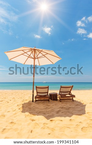 Sunbed and umbrella on Tropical beach on the island of Phuket in Thailand