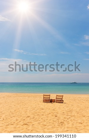 Sunbed on Tropical beach on the island of Phuket in Thailand