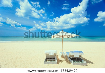 Sunbed stand on the white beach