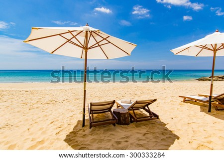 Sunbeds and umbrella at the beach in Thailand