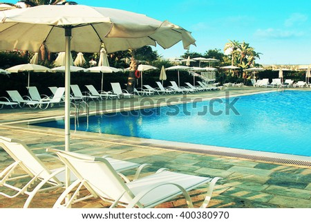Sunbeds and umbrellas by the pool