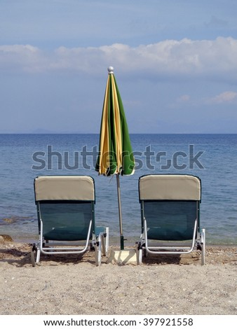 Sunbeds and umbrellas on the beach - stock photo