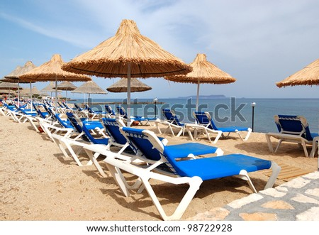 Sunbeds at the beach of luxury hotel, Crete, Greece