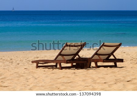 Sunbeds on a tropical beach