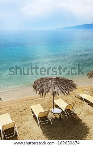 Sunbeds on the beach at modern luxury hotel, Peloponnes, Greece - stock photo