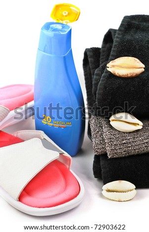 Sunblock lotion with towels and flip-flops