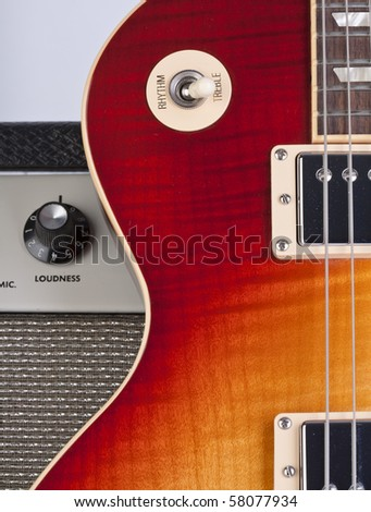 Sunburst electric guitar with amplifier - stock photo