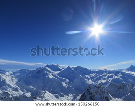 Sunburst over Verbier, Swiss Alps - stock photo