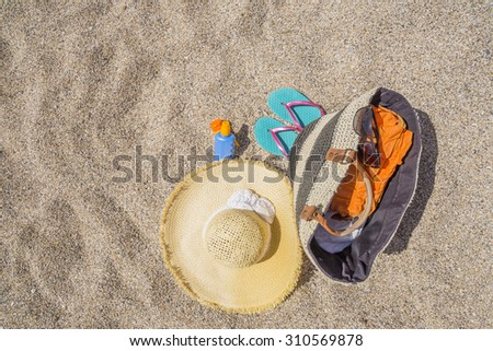 suncare sandy beach, bag hat  bottle - space for your text, background