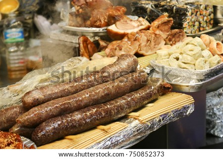 Sundae or Korean Sausage, is a Korean dish made generally by boiling or steaming cow or pig's intestines that are stuffed with various ingredients.