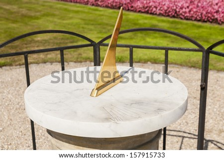 Sundial with marble base, sunny day, the time indicator.