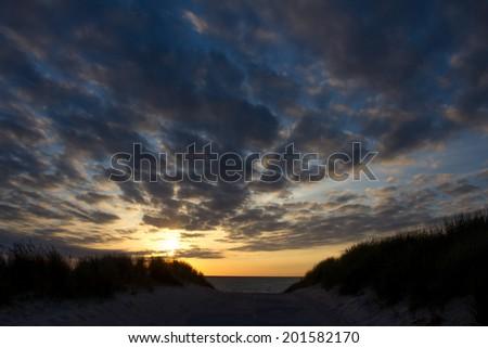 sundown at the shoreline in holland - stock photo