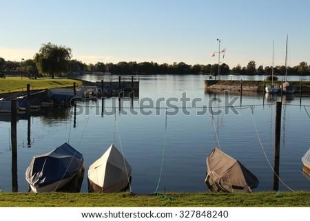 Sundown on Constance Lake (Bodensee), taken from the coast of Hard in Vorarlberg, Austria. - stock photo