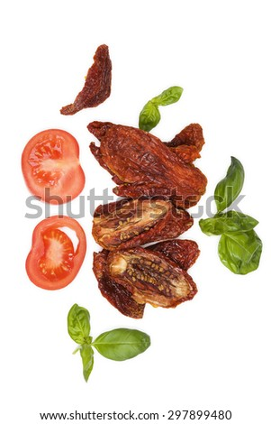 Sundried tomatos, fresh tomatoes and fresh basil herbs isolated on white background, top view. Culinary italian eating. - stock photo