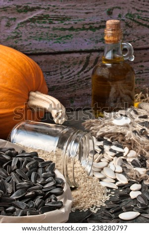 Sunflower and pumpkin seeds on the rustic wooden table