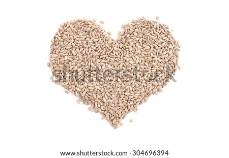 Sunflower hearts in a heart shape, isolated on a white background