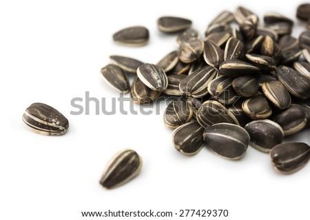 sunflower (Helianthus annuus) seeds, isolated on white. - stock photo