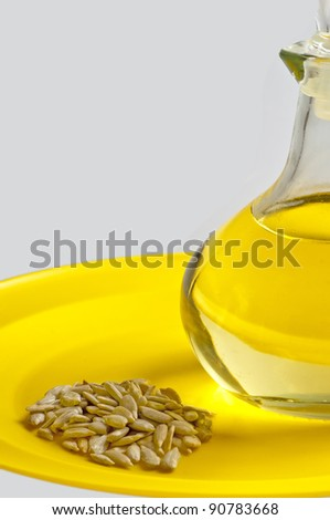 sunflower oil and sunflower seeds - stock photo