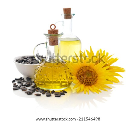 Sunflower oil in bottles with seeds and flower isolated  on white background - stock photo