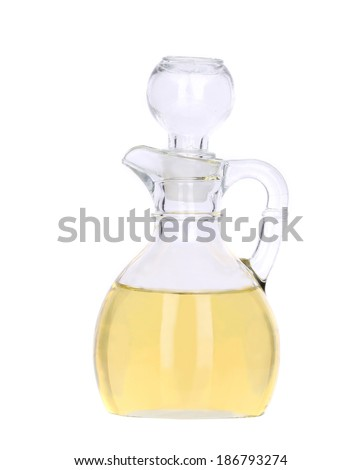 Sunflower oil in glass carafe. Isolated on a white background.