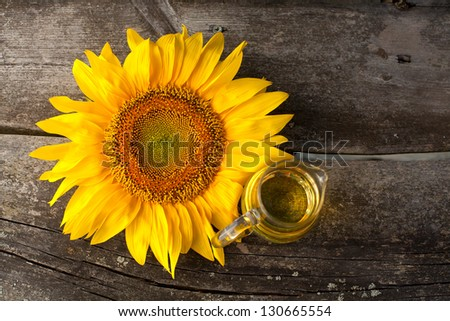 sunflower oil on wooden table - stock photo