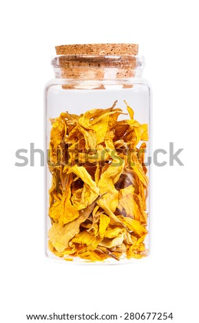 Sunflower petals in a bottle with cork stopper for medical use. - stock photo