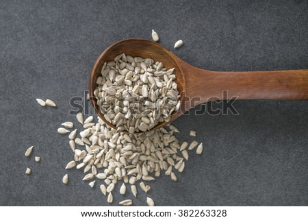 Sunflower seed with a wooden spoon. From above - stock photo